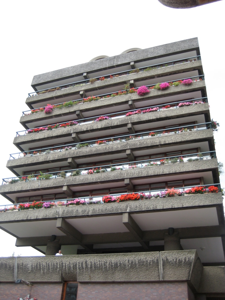Concrete tower with bright flowers