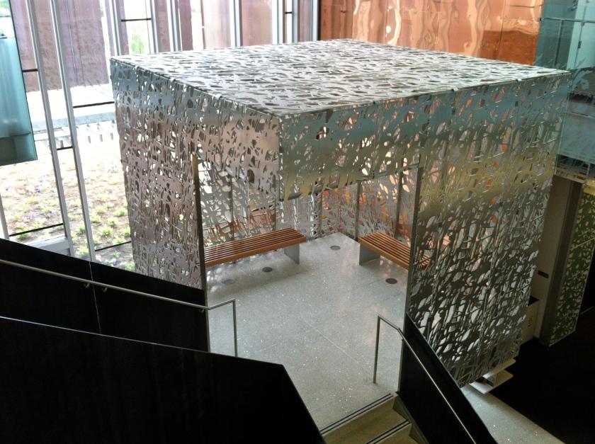 Silver metal box on a staircase landing