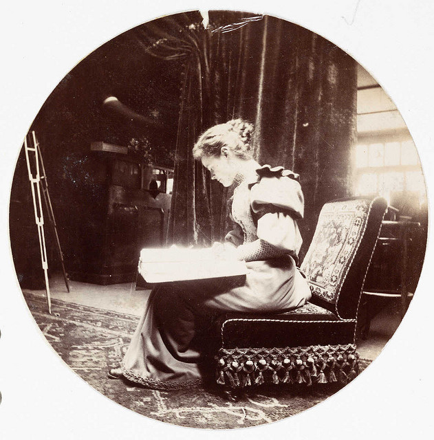 Woman reading, circa 1900