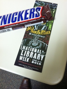 Snickers bar and a National Library Week 2015 bookmark